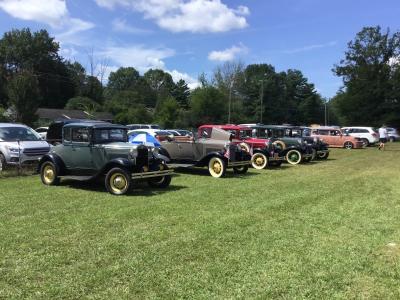 Five club member cars on display