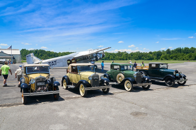 Club member Model A's in front of the Ford Tri-motor airplane